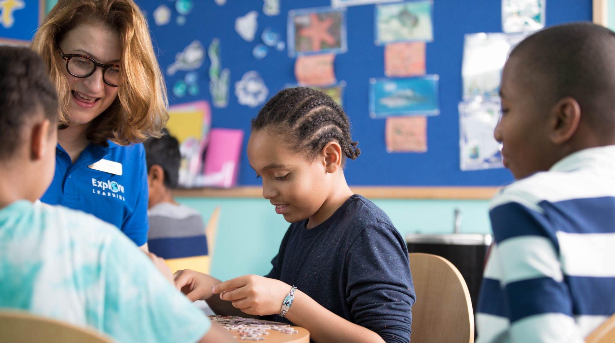 Photo of children and tutor