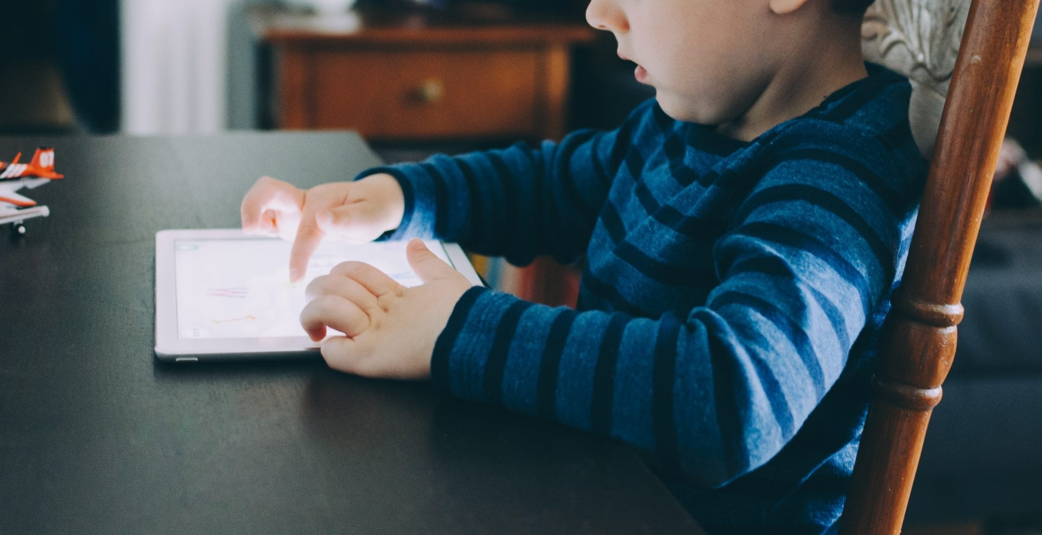 Home learning resources - student using tablet at home