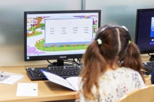 Child on a computer learning online