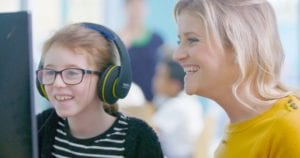 Student wearing headphones learning at computer