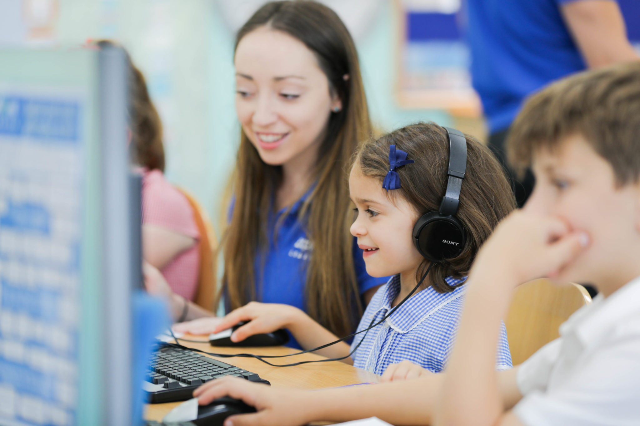 Explore Learning tutor teaching children on a computer
