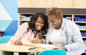 Explore Learning tutor and parent laughing