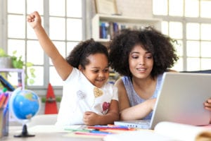 online tuition with a parent and child