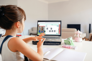 Child learning online with a tutor