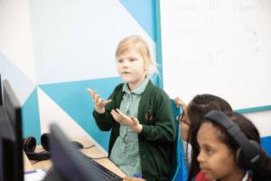 Child talking to a maths tutor