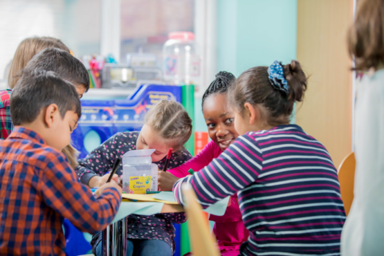 Children making friendships in the classroom
