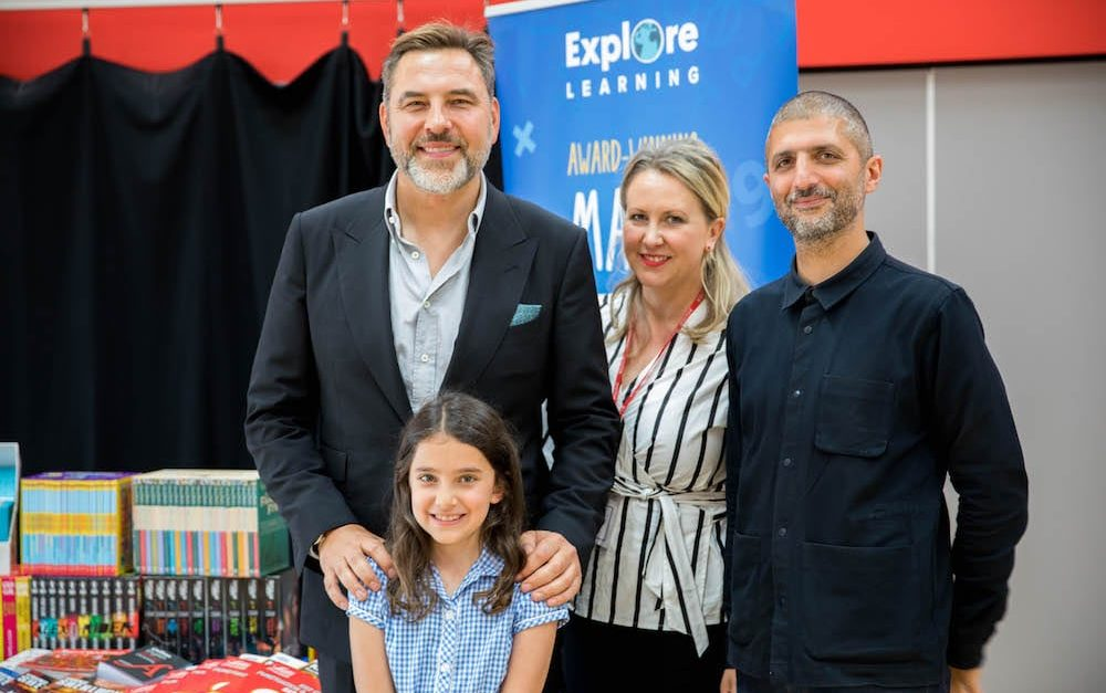 David Walliams congratulating the winner of the 2019 Explore Learning Writers' Awards with her parents.