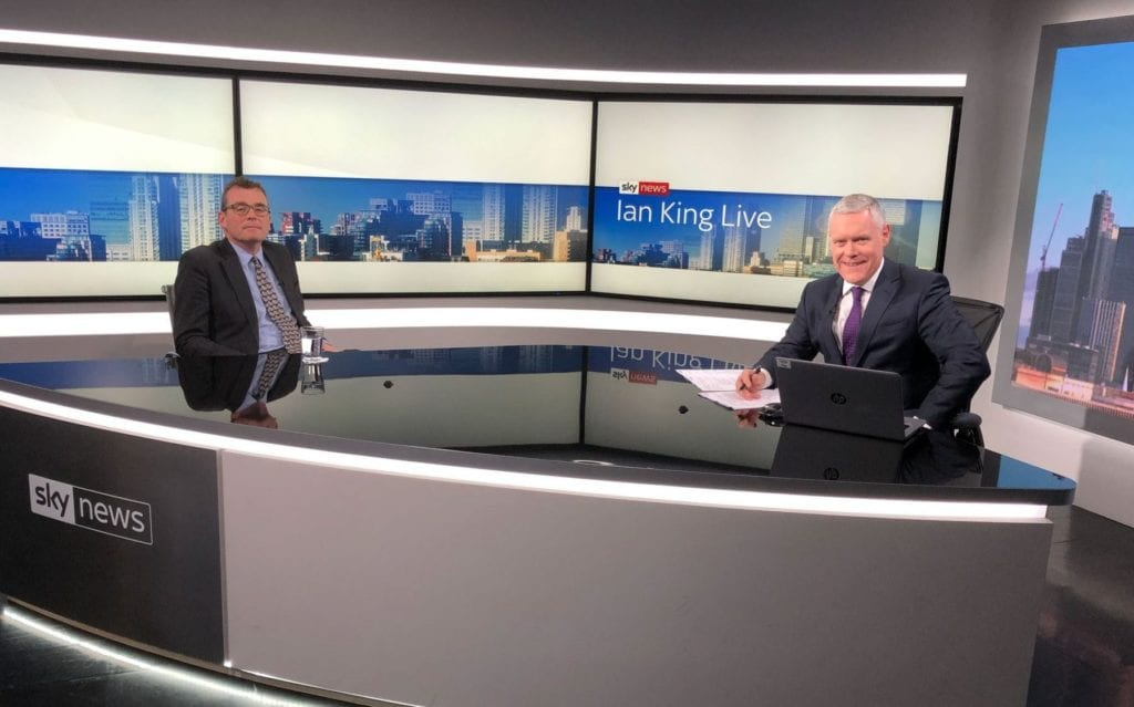CEO Bill Mills sat at a desk during an interview with Ian King on Sky News.