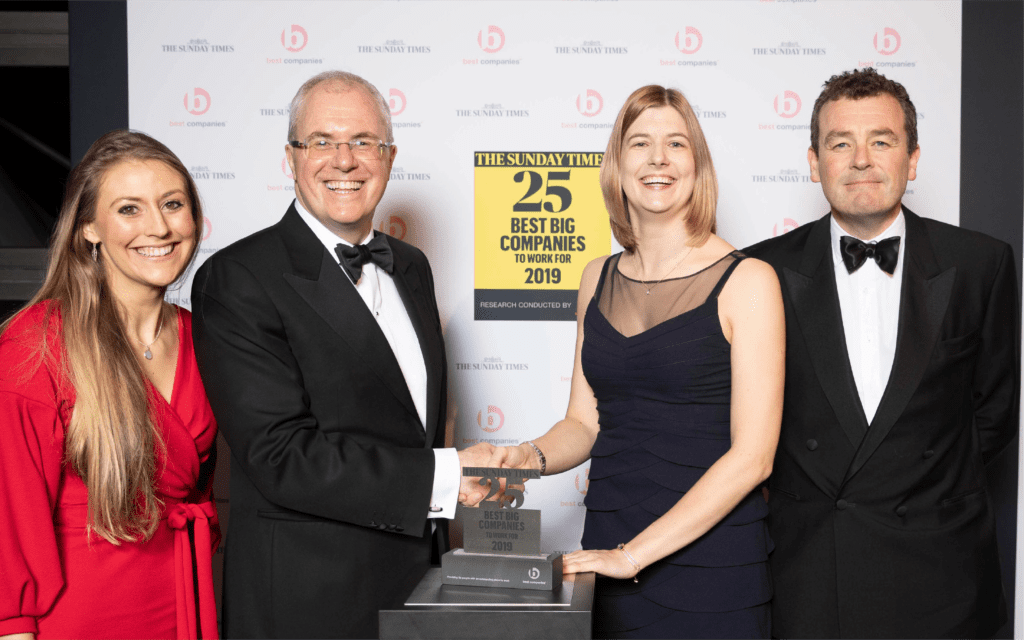 Two members of Explore Learning accepting the award for Top 25 companies to work for in the UK in 2018
