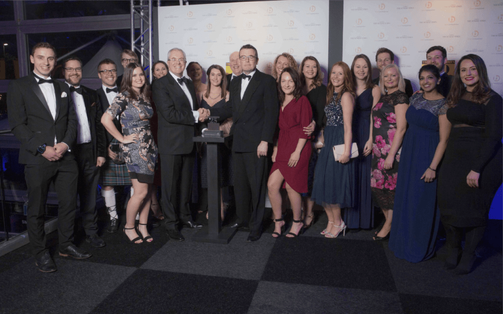 A large group of the Explore Learning team at an evening event for The Sunday Times and Best Companies awards.